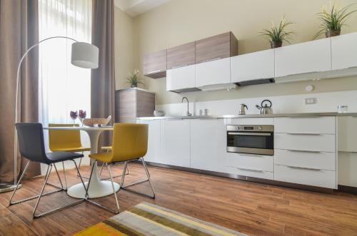 A kitchen or kitchenette at Corso di Porta Romana Halldis Apartments