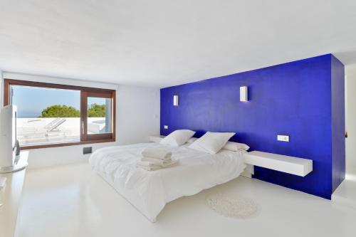 A bed or beds in a room at thesuites Ibiza Na Xemena