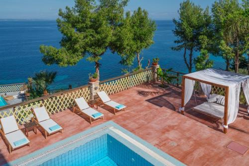 A view of the pool at Zakynthos Villas or nearby