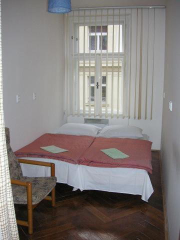 A bed or beds in a room at Hostel Bell