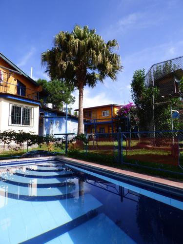 Der Swimmingpool an oder in der Nähe von Pension Topas