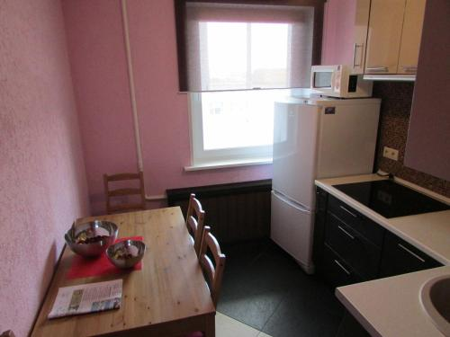 A kitchen or kitchenette at Apartment Dmitrovka Center