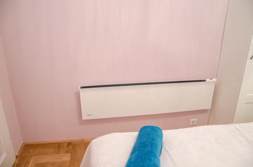 Ein Bett oder Betten in einem Zimmer der Unterkunft Blue Luxury Apartment