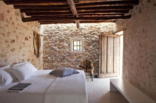 A bed or beds in a room at thesuites Ibiza Can Basso
