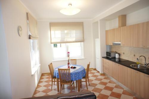 Virtuvė arba virtuvėlė apgyvendinimo įstaigoje Amber Coast & Sea