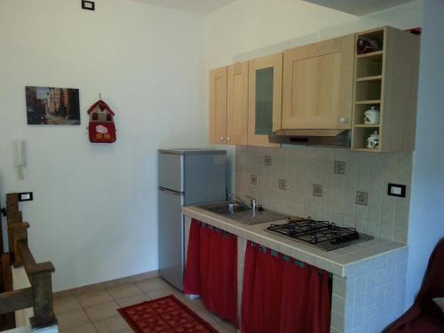A kitchen or kitchenette at Residenze Macerelli