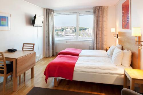 Cama o camas de una habitación en Forenom Apartments Stockholm Kista