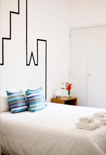 Cama ou camas em um quarto em Art Factory Soho