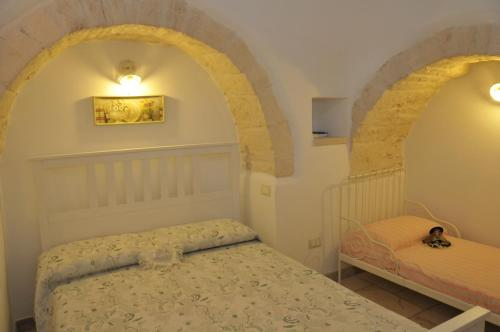 A bed or beds in a room at Trullo Relax