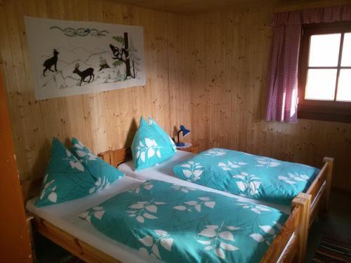 Ein Bett oder Betten in einem Zimmer der Unterkunft Almhütte Stoffer