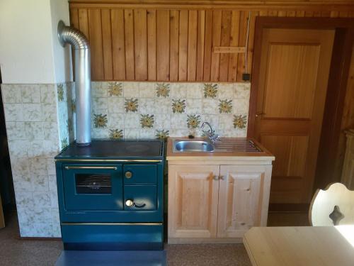 Küche/Küchenzeile in der Unterkunft Almhütte Stoffer