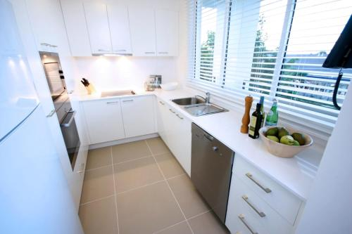 A kitchen or kitchenette at Domain Serviced Apartments