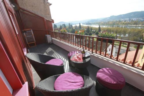 Balcon ou terrasse dans l'établissement Casas da Alegria