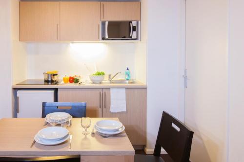 Köök või kööginurk majutusasutuses Aparthotel Adagio Access Saint Louis Bâle