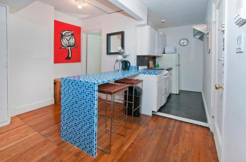 A kitchen or kitchenette at Mid Town East 28th Street Apartments Next to Times Square