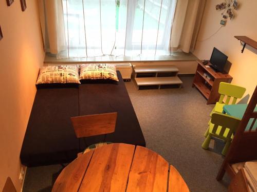 A seating area at Apartmány Čertovka- APT Farao