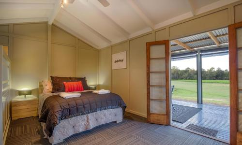 A bed or beds in a room at Windfall Estate Vineyard Cottage