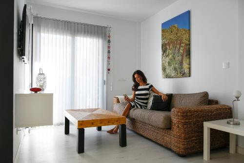 A seating area at Pura Vida Beach Suites