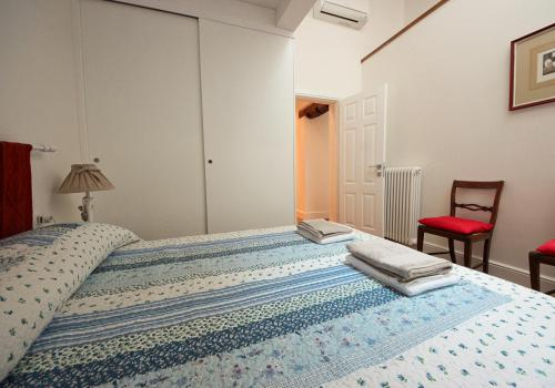 A bed or beds in a room at Ottaviani Terrace