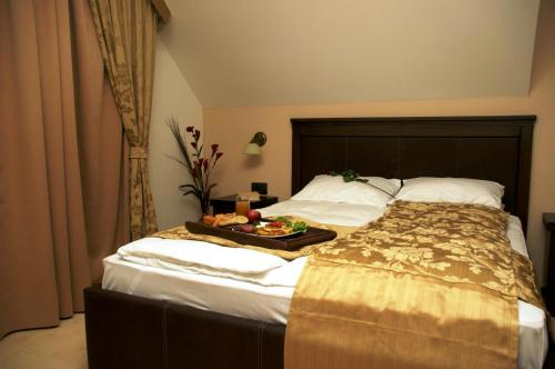 A bed or beds in a room at Vila Pina
