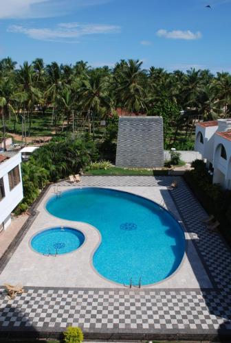 A view of the pool at Malpe Sea Front Cottages or nearby
