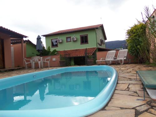 The swimming pool at or near Casa Recanto Cuiabá