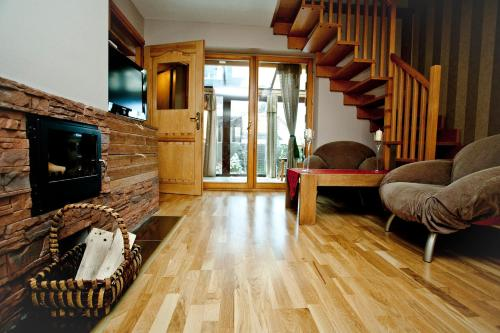 A seating area at Apartament Rodzinny Limba