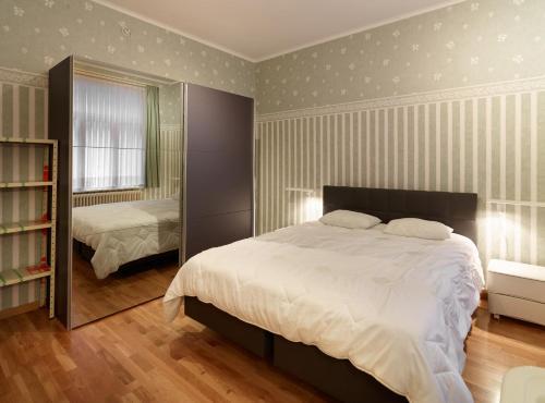 Een bed of bedden in een kamer bij Residentie Kursaal