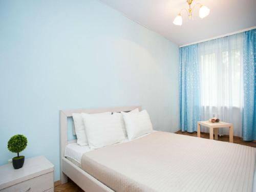 Кровать или кровати в номере Inndays on Nagornaya