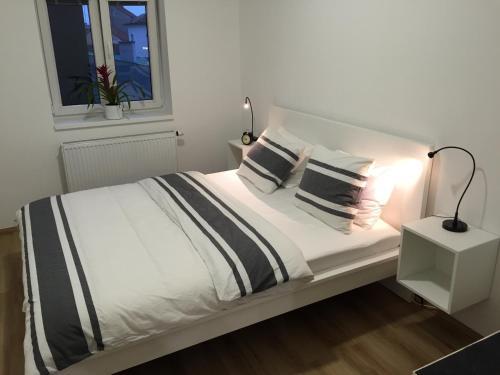 Ένα ή περισσότερα κρεβάτια σε δωμάτιο στο Apartment Na Kopečku