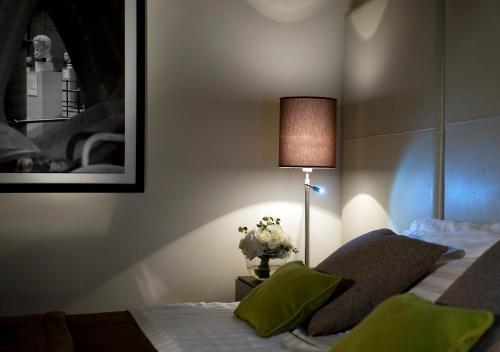 Cama ou camas em um quarto em Palazzo Al Velabro