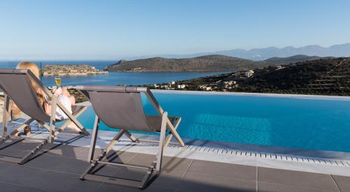 The swimming pool at or near Elounda Luxury Villas