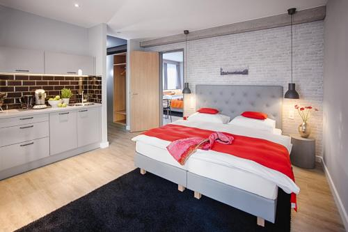 A bed or beds in a room at MLOFT Apartments München