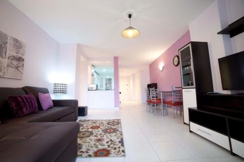 A seating area at Apartamentos Kasa25 Golf & Beach Hoyo 18