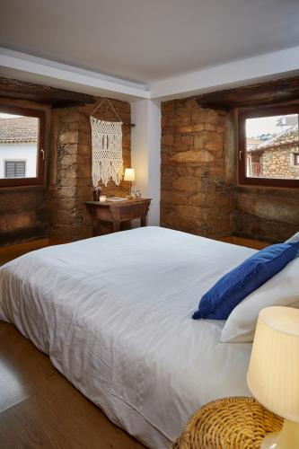 A bed or beds in a room at Casa De Janeiro