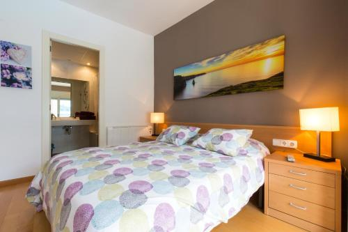 A bed or beds in a room at Apartamentos Can Saula
