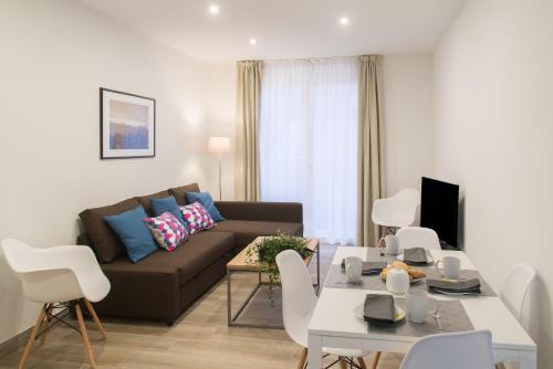 Zona de estar de Apartamentos Campo Del Príncipe