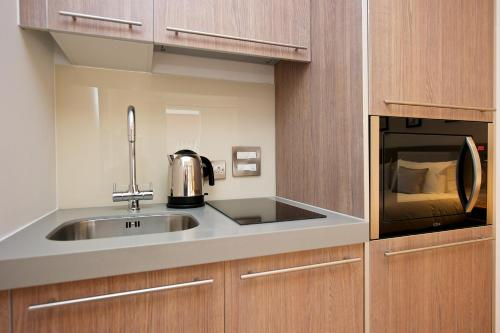 A kitchen or kitchenette at Staycity Aparthotels Birmingham Central Newhall Square