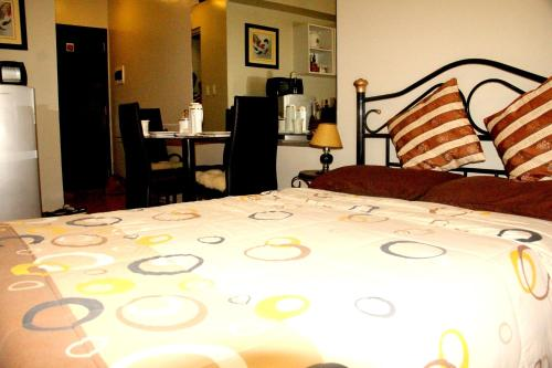 A bed or beds in a room at Marella Suites