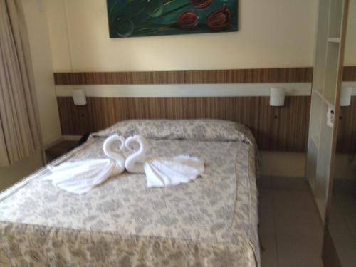 A bed or beds in a room at Lacqua Diroma