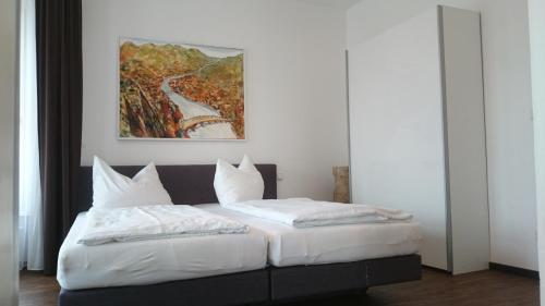 Ein Bett oder Betten in einem Zimmer der Unterkunft Ferienwohnung Trunzergasse