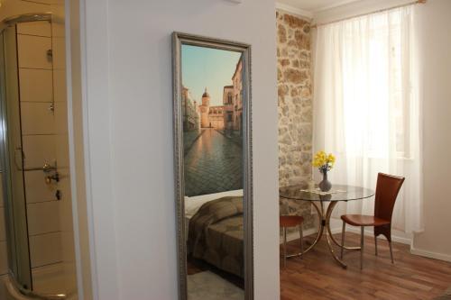 Cama ou camas em um quarto em City Break Dubrovnik Apartments