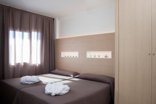 Кровать или кровати в номере Aparthotel Acualandia