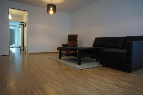 Ein Sitzbereich in der Unterkunft Deluxe Apartment Cologne