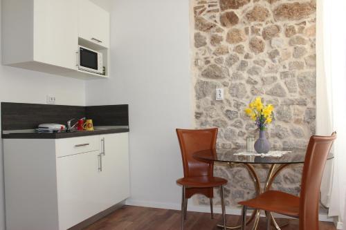 A cozinha ou cozinha compacta de City Break Dubrovnik Apartments