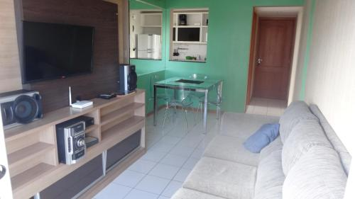 A television and/or entertainment center at Ajuricaba Suites 6