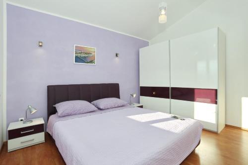Posteľ alebo postele v izbe v ubytovaní Apartments Maslina Božava
