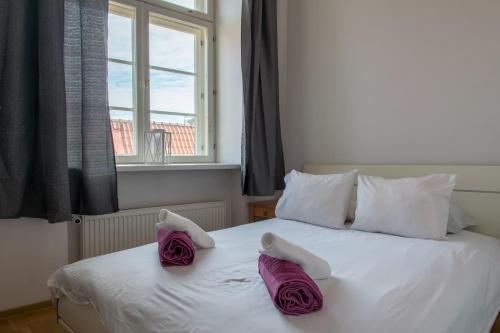 Voodi või voodid majutusasutuse Parkers Boutique Apartments - Old Town Square toas