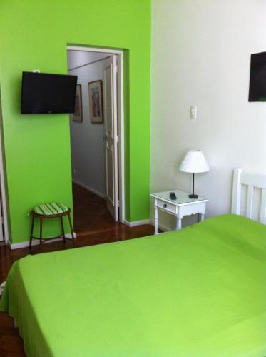 A bed or beds in a room at Heart of Copacabana: 1 Min. from Beach