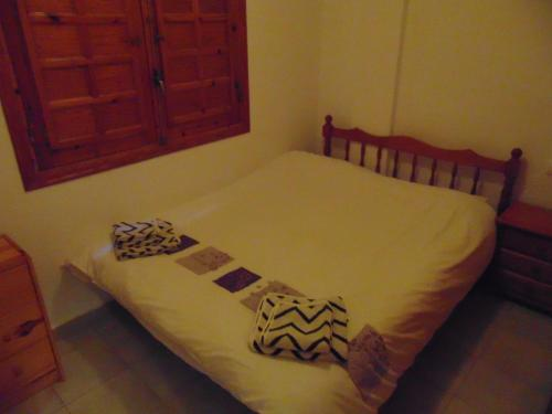 A bed or beds in a room at Duplex Puertosol